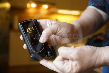 Hyperglycemic diabetic patient testing her sugar level