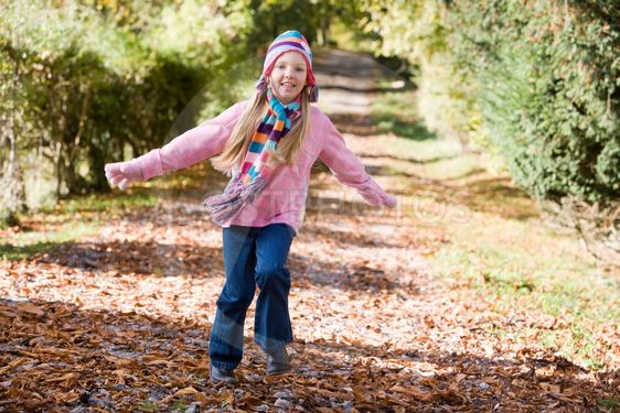 Young girl playing in woods