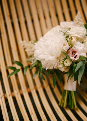 bridal bouquet of white peonies, roses, pink eustoma,...