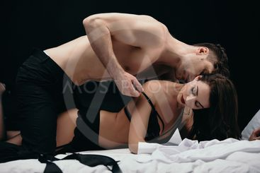 man kissing and undressing beautiful sexy woman isolated...