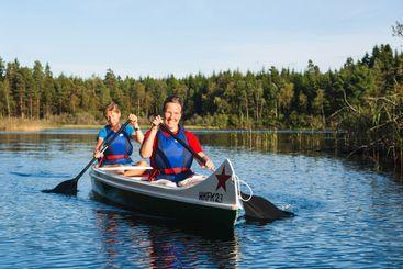 Two woman paddling canoe, Sweden