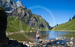 Young girl hiking around Bannalpsee in Switzerland