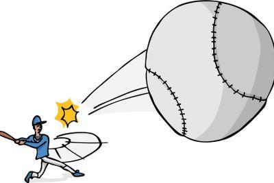 Softball Player Hits the Ball