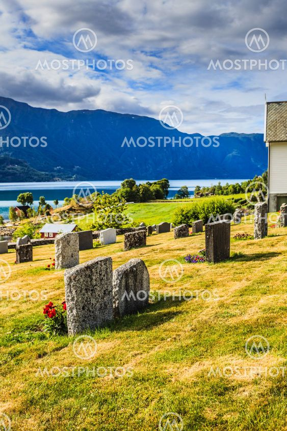 Churchyard in Nes village at fjord, Norway