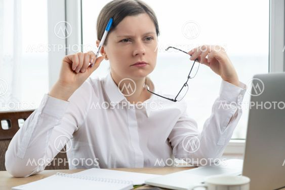 Woman working with computer, get sad thinking expression