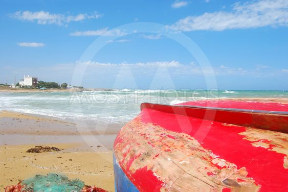 Boats ashore on the coast of Apulia of Torre Canne -...