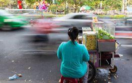 Asian seller long exposure on traffic road