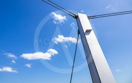 a pole in front of a blue sky