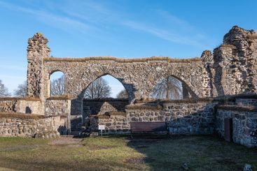 Ruins of Gudhem abbey with stones and arches.
