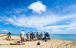 SRI LANKA - Mach 23: Local fishermen pull a fishing net...