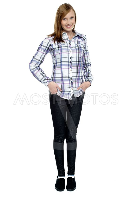 Trendy girl with long hair posing smartly
