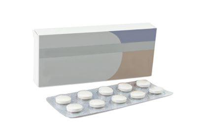 Pills antibiotics tablets on white background