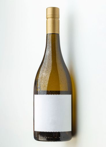 a white wine bottle with blank label