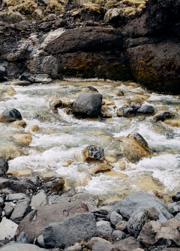 Close-up of rocks in the mountain river, washed quickly...
