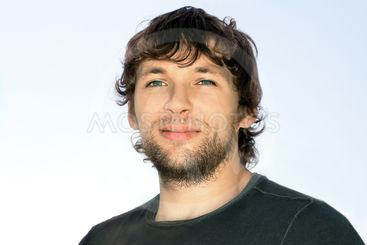 Young Man with Curly Hair and Beard Face attractive