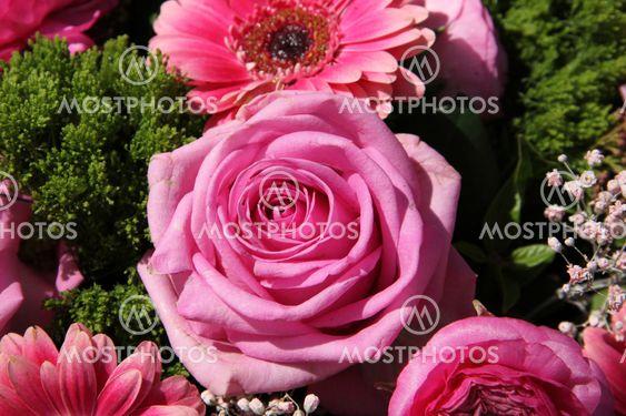 Pink rose in a bridal arrangement