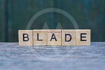 word blade of brown wooden letters on a gray table