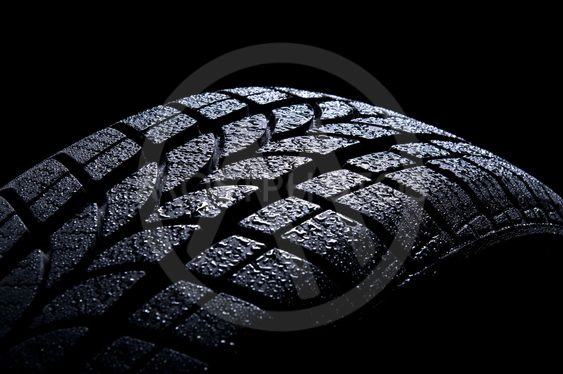 Car tire isolated on black background