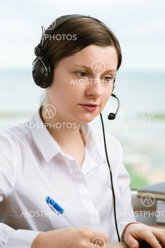Woman with headset working in office to solve problems