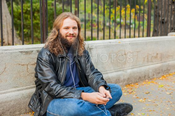 Blond Beard Young Adult Hipster Man Listening Music