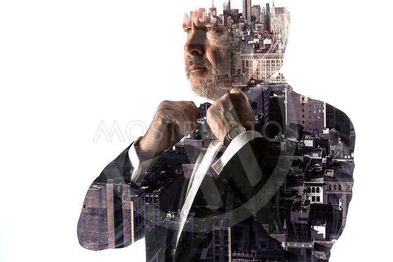 Portrait of bearded businessman. Double exposure city on...