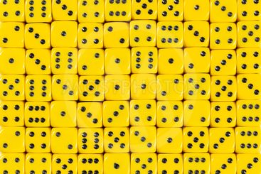 Background pattern of 70 yellow dices, random ordered