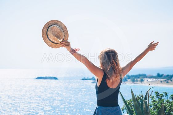 Young woman enjoying the view by the sea