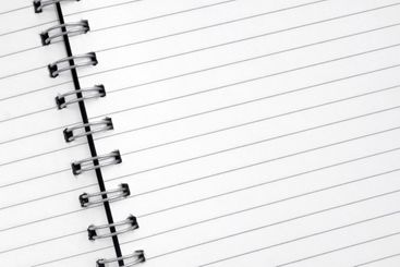 Close up of lined paper in a spiral notepad.
