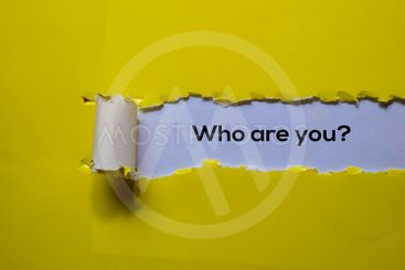 Close up Who Are You? written in yellow torn paper
