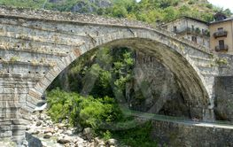 The arch of the ancient Roman bridge in the town of Pont...