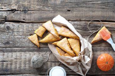 Glazed homemade scones sandwich pumpkin cookies, with...