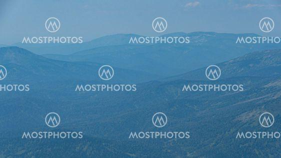 View of calming mountain valley with ridge on horizon....