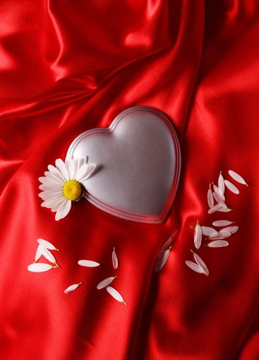 Heart on red satin