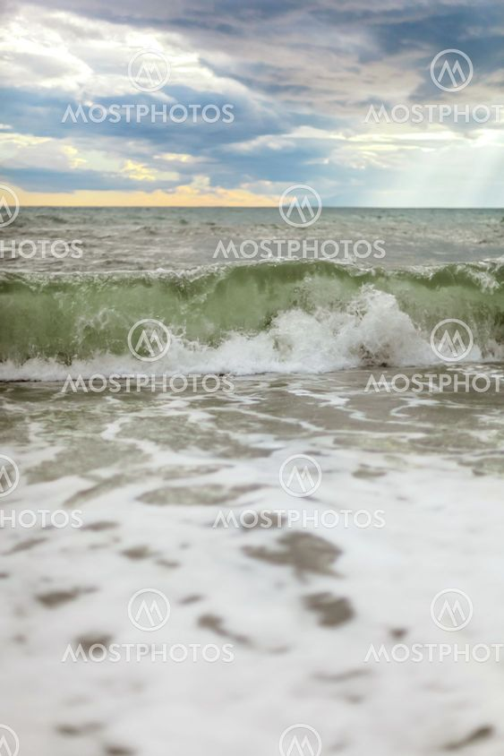 Sea or ocean cloudy sky wave after storm. Space for text.