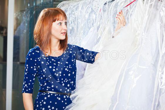 Beautiful girl chooses her wedding dress.  Portrait in...
