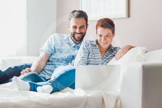 Young couple watching laptop