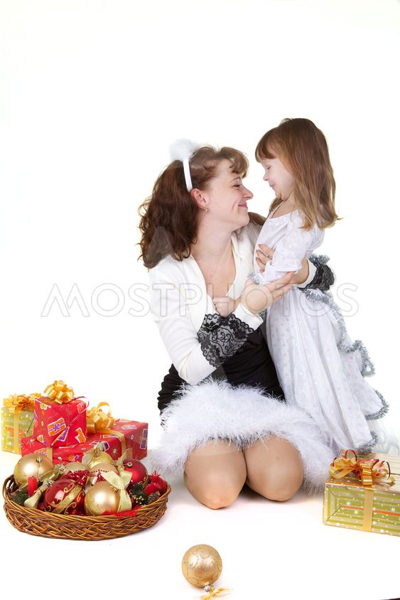 Mother with daughter and christmas toys