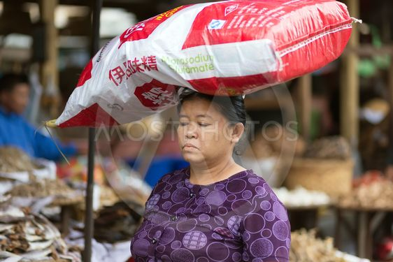 Woman carrying monosodium glutamate bag