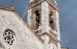 Ancient bell tower in white stone and red bricks of an...