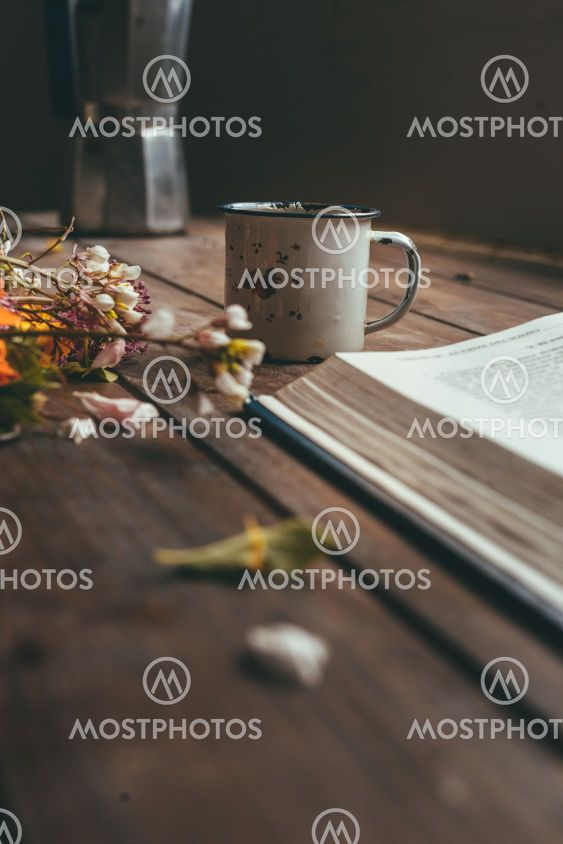 Flowers, coffee and book on the table