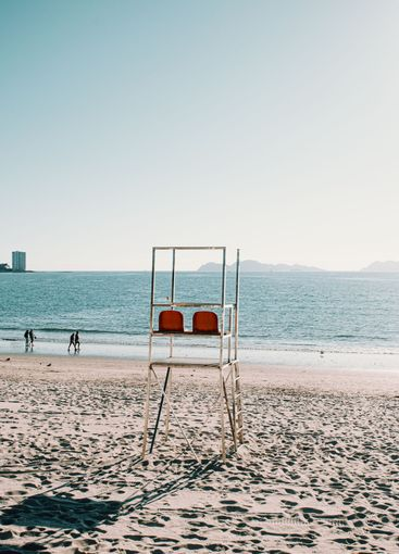 Baywatch chairs on the beach in Spain during summer
