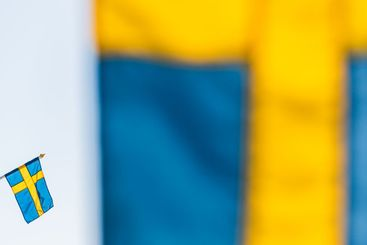 Swedish flag behind another flag