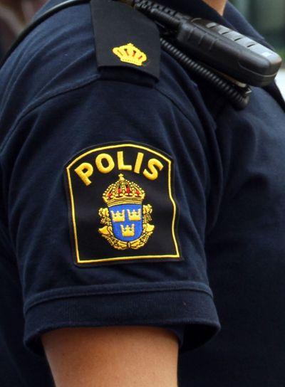 Polis märke på uniform