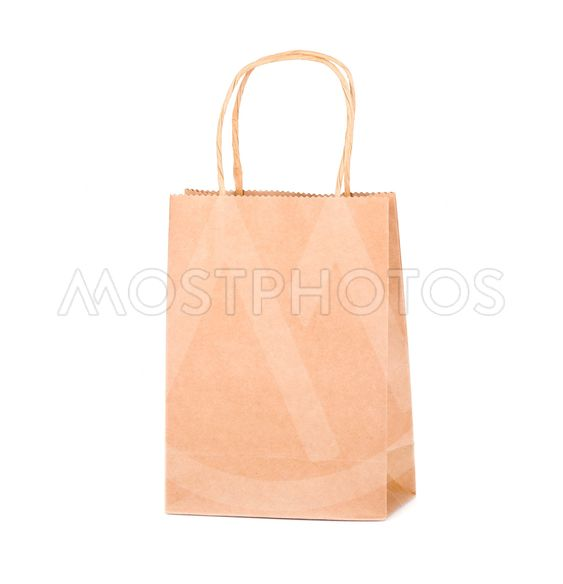 Craft paper bag isolated on white background. Packaging...