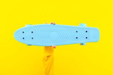 skateboard in hand