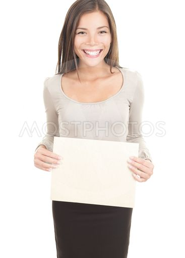 Woman holding paper sign