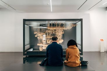 Tourists in the museum look at rope model invented by...