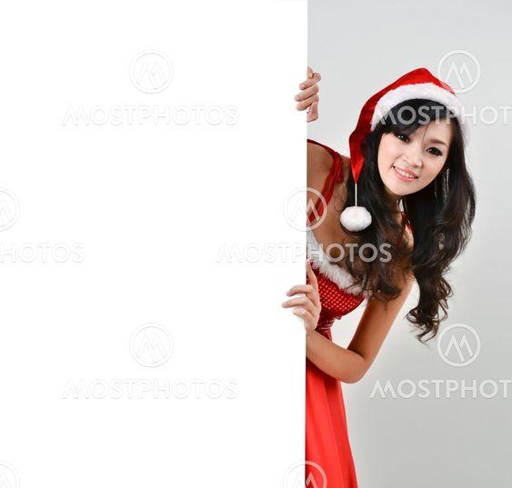 Santa kvinna som håller en vit affisch