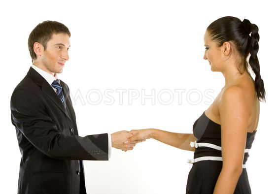 Successful young business executives shaking hands