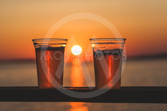 Two beer cups with setting sun